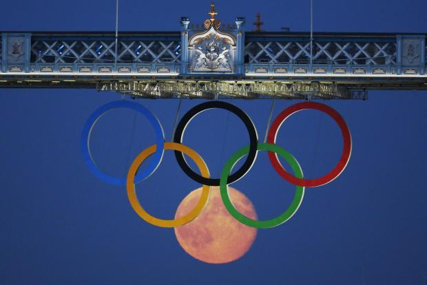 Moon among the Olympic rings in London
